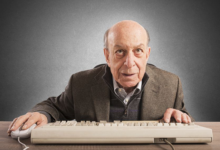 Elderly man at keyboard