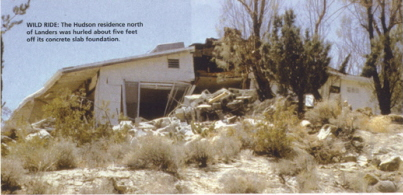 photo of quake-damaged house with caption